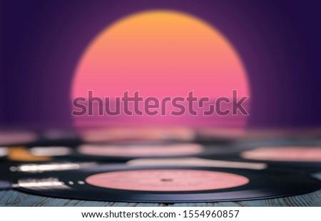 Vinyl discs on the table on retro background