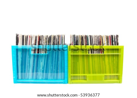 Vinyl disks in plastic boxes isolated on white, closed-up