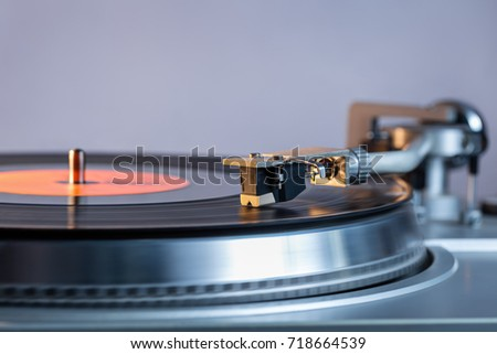 Vinyl player. Vinyl plate and needle close-up.  #718664539