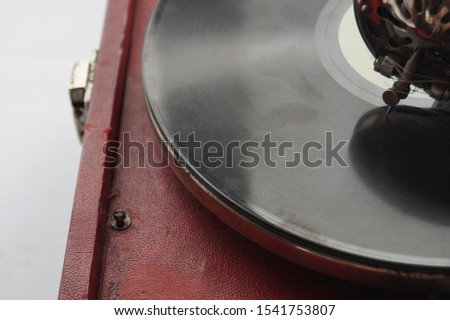 vinyl record and red record player on a white background #1541753807