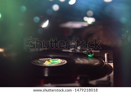 Vinyl record in the dance club with disc jockey