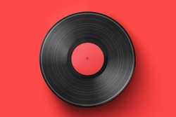 Vinyl record on a colored background. Old vintage vinyl record isolated
