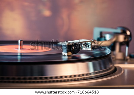 Vinyl record player, bright lights disco-bokeh. Needle on vinyl record. #718664518