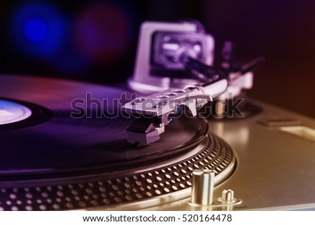 Vinyl record player for DJ. Turntable playing analog music records.