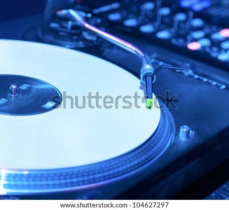 Vinyl record player in nightclub closeup