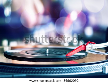 Vinyl record spinning on DJ player