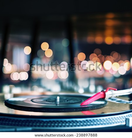 Stock Photo Vinyl record spinning on DJ turntable