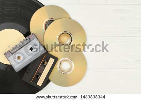 Vinyl record, tape cassettes and compact discs. DVD discs, audio cassette tapes, gramophone record and copy space. Set of musical devices.