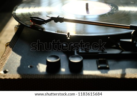 vinyl record vintage analog music recording medium on a turntable, Gramophone with a vinyl record, Old record player stylus on a rotating disc,music tools. #1183615684