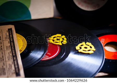 Vinyl records and adaptors #1064229626