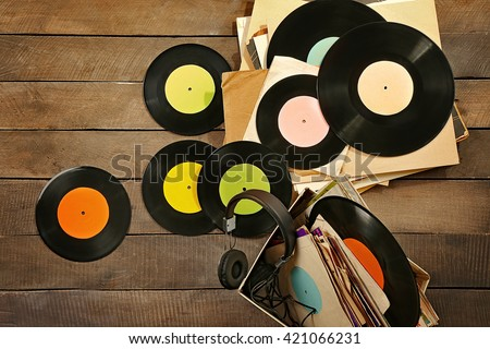 Vinyl records and headphones on table #421066231