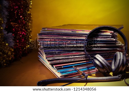 Vinyl records & headphones. Professional hi-fi audio equipment for sound enthusiast.Melomania and audiofile.Vintage and retro style #1214348056