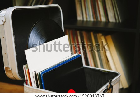 Vinyl records in transport case.Tour dj audio equipment.Old analog vinyls in paper sleeve covers.Professioinal disc jockey gear for nightclub party.Hi-fi record collection in sound recording studio #1520013767