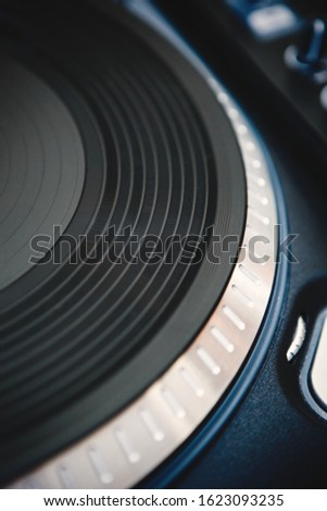 Vinyl records player in close up.Turntable for disc jockey.Retro style analog turntables with music.Professional disc jockey audio equipment in night club.Listen to classical music in hi-fi quality