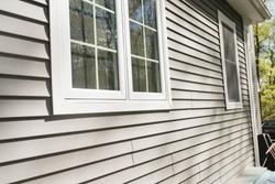 vinyl siding on house with window frames
