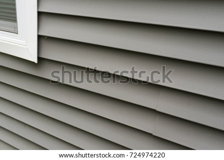 Vinyl siding texture installed for weathering protection on new residential home - Shutterstock ID 724974220