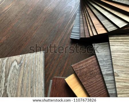 vinyl tiles collection : Luxury Vinyl floor tile or rubber flooring sample stack for interior design idea #1107673826