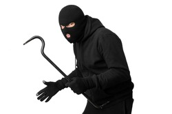 Violence Concept. Half-turned thief wearing black mask and hoodie looking angrily at camera, isolated on white background