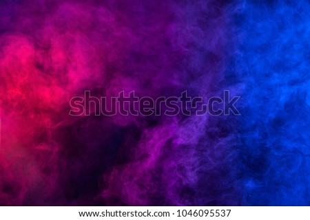 Violet and blue smoke texture on a black background. Texture and abstract art