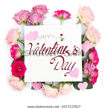 Violet and pink blooming fresh rose flowers and hearts with Happy Valentine's Day Greeting #1017137827