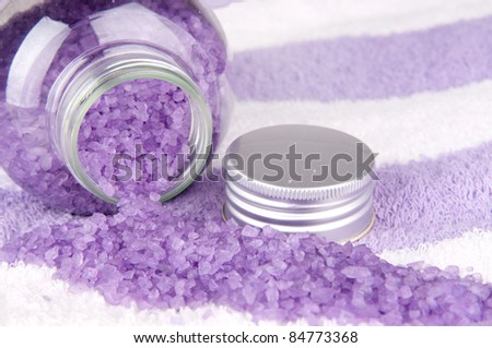 Violet bath salt on towel background