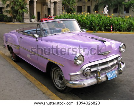 violet classic car used as a...