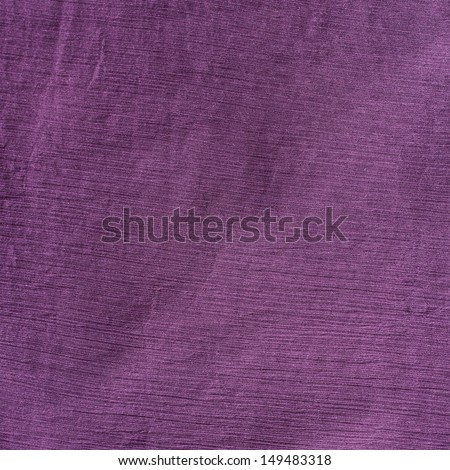 Violet cloth material fragment as a background texture