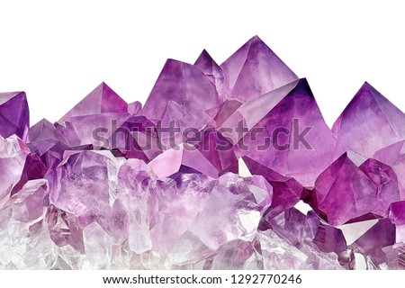 Violet Crystal Stone macro mineral surface. Purple rough Amethyst quartz crystals geode on white background, Uruguay