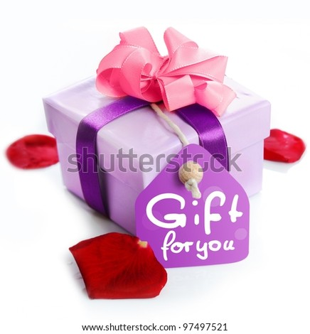 violet Gift Box with a card, a ribbon and the words Gift for you. Red Rose leaves isolated on white background