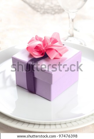 violet Present or Gift Box with a pink bow and a lilac ribbon