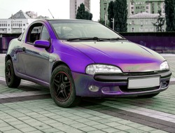 violet small sportcar with closed doors