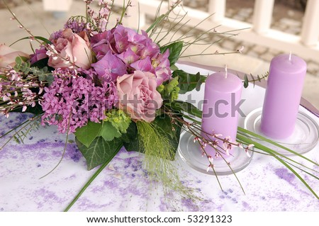 stock photo Violet wedding decoration with flowers and candles