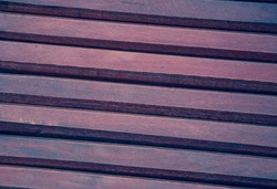 Violet wooden background. Shadowed angles.
