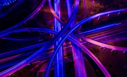 Violets , purples , and blues aerial drone straight down angle above highways and interchange overpass , a travel destination transportation Infrastructure new technology future scene
