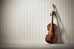 Violin and bow on a vintage wallpaper