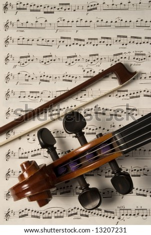 Violin and bow on music chart sheet