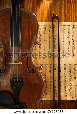 violin and fiddle stick on note
