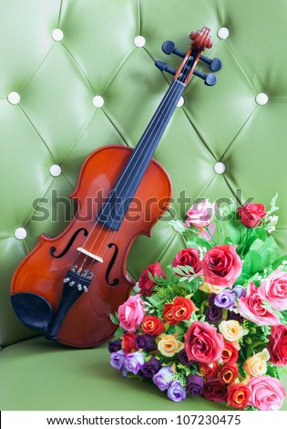 violin and flower on luxury green leather background