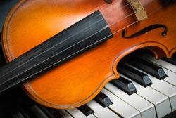 Violin and piano keyboard closeup part fot music background