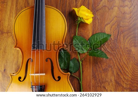 Violin, art palette, brushes and yellow rose