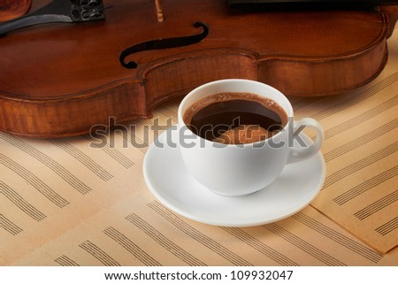 violin background with coffee cup