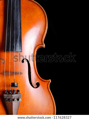 Violin close-up on black background
