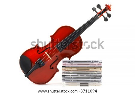 Violin leaning on stack of compact discs on white background, top angle view, horizontal orientation. Depicts a career in classical music. Commercialization of classical music.