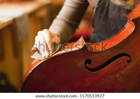 Violin maker restoring a cello