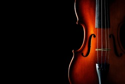 Violin on a black background. Ancient stringed instrument. Classical music.