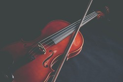 Violin on a black background,Classical violin isolated on dark background. Classical musical instrument,Top view violin black background