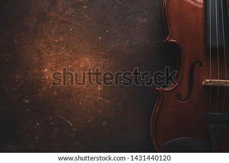 Violin on a black background,Classical violin isolated on dark background. Studio shot of old violin. Classical musical instrument,Top view violin black background Сток-фото ©