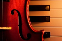 violin on electric piano with candle light.