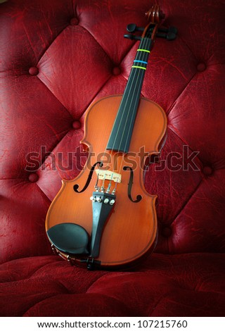 violin on luxury red leather background