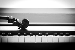 Violin on piano. Black and White color tone. Art and music concept. Still life and high contrast style. With dark vignette.